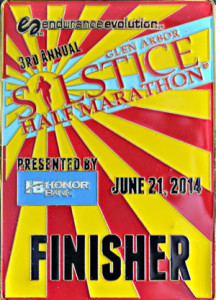 The 2014 half marathon finisher medal (which makes for a great summer solstice amulet.)